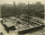 Steel beam hoisting cranes installed at building site of new Central Library of the Enoch Pratt...