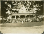 1927 Better Homes Tour participants standing before a home demonstrating how to beautify grounds...