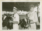 Page K. Ifert (left), winner of the Wimbledon trophy for Best Fitted 4-H Holstein at the Maryland State Fair held in...
