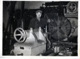 Charles Albert Booth working in machine shop
