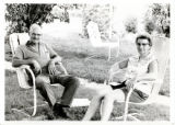 Chas and Virginia Axline sitting on lawn chairs