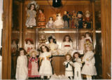 Antique doll collection in display case at the Potomac River Festival