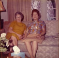Two women sitting on couch