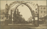 Crossing double triumphal arches spanning the intersection of Lexington Street and Park Avenue...