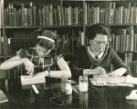 WPA Project Number 123 - Book repair at the Enoch Pratt Free Library in Baltimore, workers using...