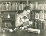 WPA Project Number 123 - Book repair at the Enoch Pratt Free Library in Baltimore, worker using a...