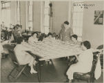 WPA Project Number 136 - Workers engaged in a sewing project at a training work center in...