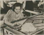 WPA Project Number 136 - Worker making a hooked rug at a training work center in Hagerstown