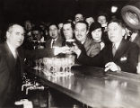 "H. L. Mencken accepting ""his first public glass of post-Prohibition beer"" at Rennert..."