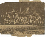 Newspaper clipping of photograph with caption reading The Woman's Land Army gathering nuts in Virginia for gas [mask...